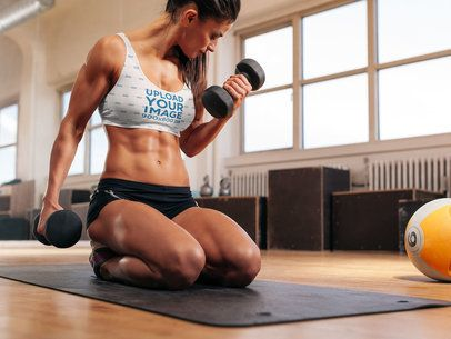 Sports Bra Mockup of a Woman Lifting Dumbbells 37118-r-el2
