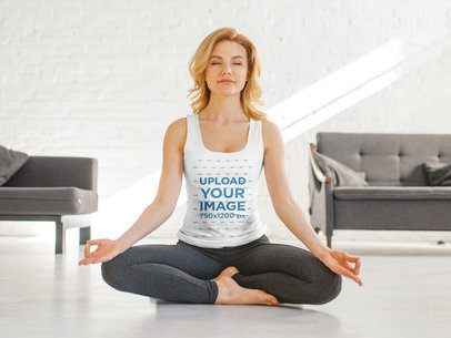 Mockup of a Happy Woman with a Tank Top Meditating in a Modern Living Room 37187-r-el2