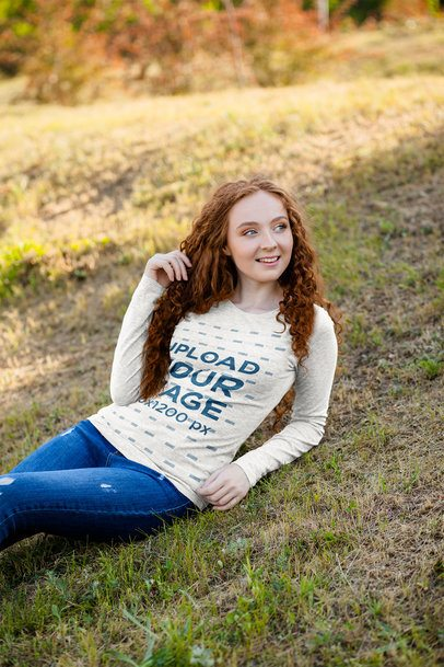 Heather Long Sleeve Tee Mockup of a Woman Lying on the Grass 4731-el1