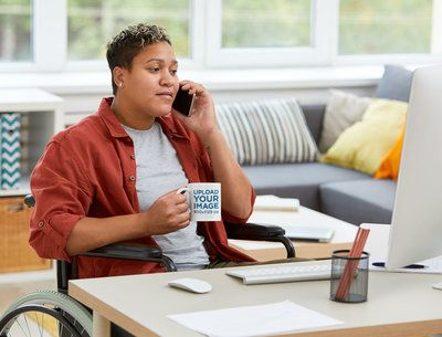 Mockup of a Woman with an 11 oz Mug Working from Home 38073-r-el2