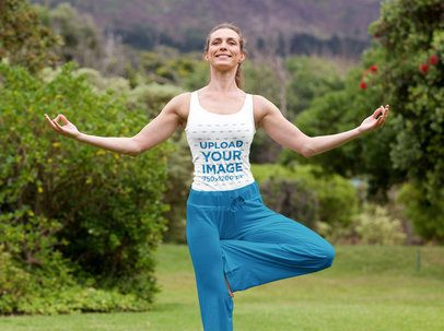 Mockup of a Happy Fit Woman with a Tank Top Meditating in Nature 37964-r-el2