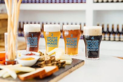 Mockup Featuring Four Beer Glasses Placed by a Cheeseboard 35484-r-el2