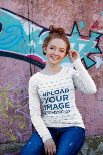 Heather Long Sleeve Tee Mockup of a Young Woman Sitting in Front of a Graffitied Wall 4732-el1