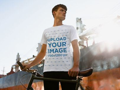 T-Shirt Mockup of a Man with His Bike in the City 38726-r-el2