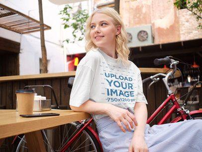 T-Shirt Mockup of a Woman at a Coffee Shop 38683-r-el2