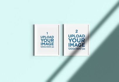 Mockup of Two Framed Art Prints Hanging on a Solid Color Wall 4834-el1