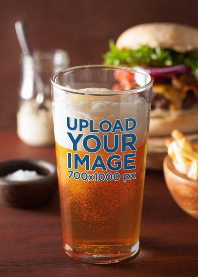 Beer Glass Mockup Featuring a Burger in the Background 35449-r-el2