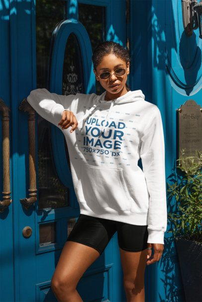Hoodie Mockup of a Woman With an Athleisure Style Posing by a Blue Door 4851-el1
