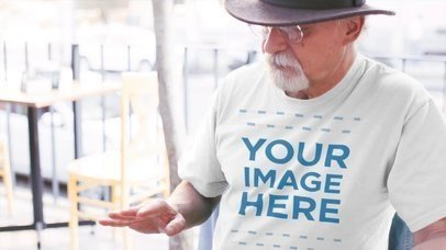 T-shirt Mockup Video of an Elderly Man Having a Chat in the Street a12782-122716