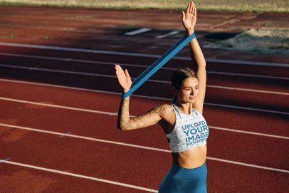 Sports Bra Mockup of a Tattooed Woman at a Running Track 38595-r-el2