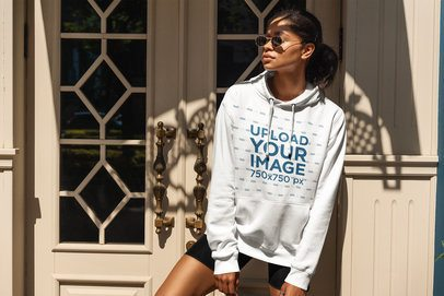 Hoodie Mockup of a Woman With an Athleisure Style Posing by a Vintage Door 4853-el1