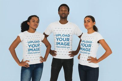 T-Shirt Mockup of a Man and Two Women Striking a Power Pose 26413