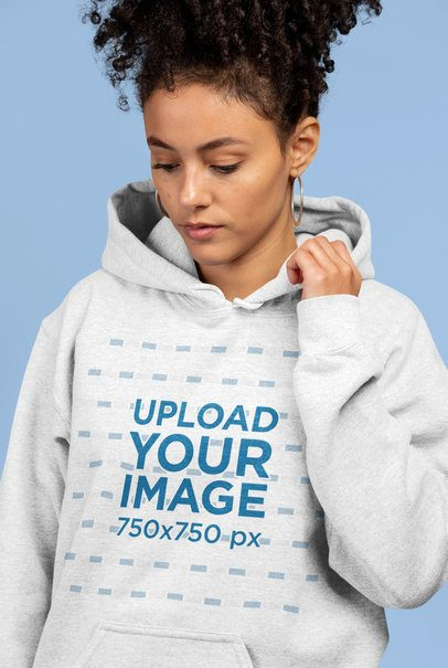 Mockup of a Woman Wearing a Heathered Hoodie in a Studio 23963