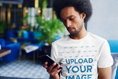 T-Shirt Mockup of a Man with a Beard Checking His Phone 38955-r-el2