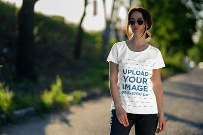 Tee Mockup of a Woman Standing on a Country Road 4861-el1