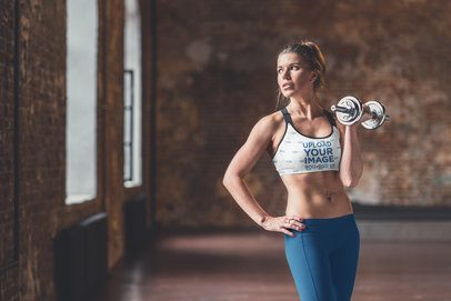 Sports Bra Mockup of a Woman Lifting a Dumbbell 38628-r-el2