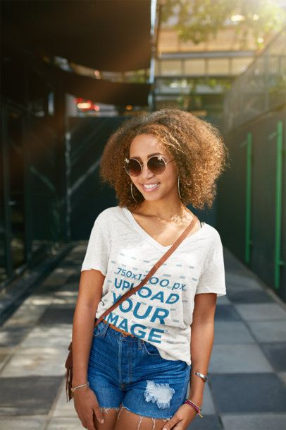 Mockup of a Smiling Woman with a Heathered V-Neck Tee Posing on the Street 38807-r-el2
