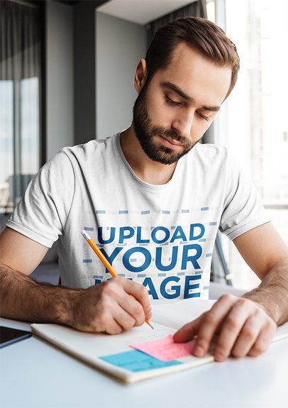 T-Shirt Mockup of a Serious Man Taking Notes 38152-r-el2