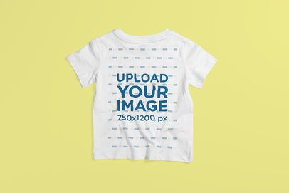 Back-View Mockup of a Kid's T-Shirt Placed on a Colored Surface 4869-el1