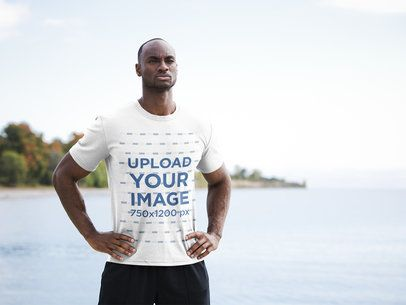 Activewear T-Shirt Mockup of a Fit Man Standing by a Lake 38678-r-el2