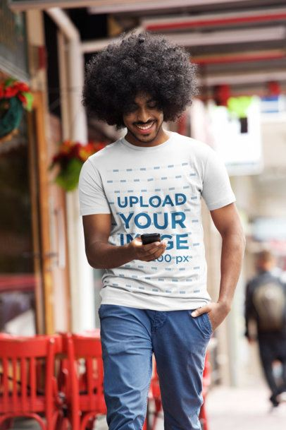 T-Shirt Mockup of a Happy Man Walking Down the Street 35384-r-el2