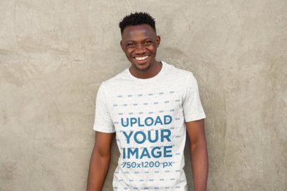 Mockup of a Smiling Man Wearing Round Neck Tee Against a Concrete Wall 37571-r-el2