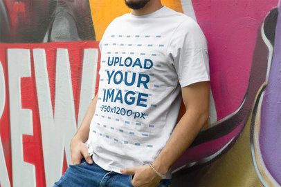 T-Shirt Mockup of a Man Leaning on a Wall with Graffiti 4871-el1