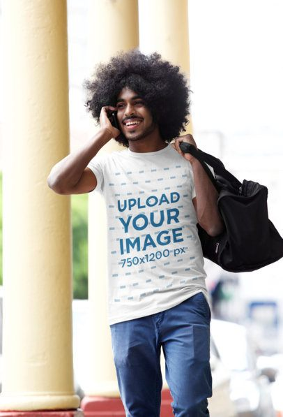 T-Shirt Mockup of a Man on the Phone Walking on the Street 37599-r-el2