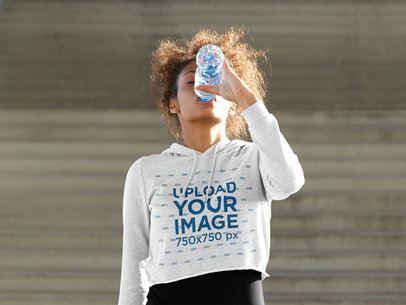 T-Shirt Mockup of a Fit Woman Wearing a Crop Top Hoodie 38803-r-el2