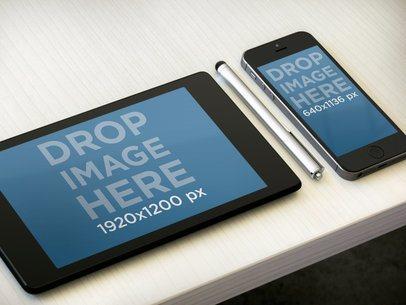 Multistage Apple iPhone 5s Black Portrait Vs Google Nexus 7 Black Landscape On Light Desk