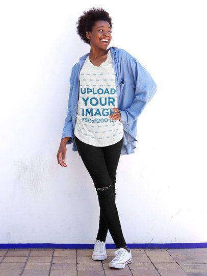 Mockup of a Happy Woman with a Heathered T-Shirt Posing by a White Wall 38793-r-el2