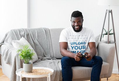 T-Shirt Mockup of a Man Playing Video Games at Home 38911-r-el2