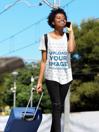 Mockup of a Woman with a Loose T-Shirt Carrying a Suitcase 38797-r-el2