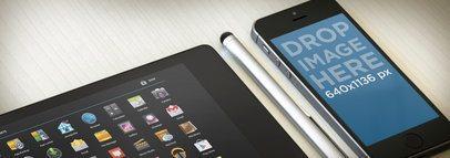 Multistage Apple iPhone 5s Black Portrait Vs Google Nexus 7 Black Landscape On Light Desk Wide