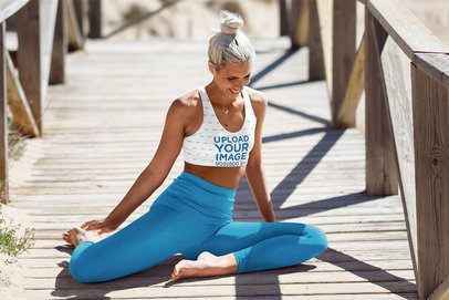 Mockup of a Woman with a Sports Bra Doing Yoga by the Beach 38374-r-el2