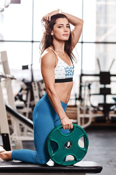 Mockup of a Woman Wearing a Sublimated Sports Bra and Posing at the Gym 38622-r-el2