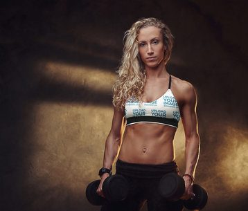 Mockup of a Strong Long-Haired Woman Wearing a Sublimated Sports Bra 38642-r-el2