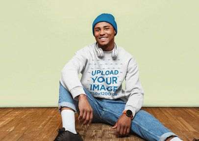 Crewneck Sweatshirt Mockup of a Happy Man Sitting on a Wooden Floor 38938-r-el2