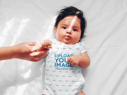 Sublimated Onesie Mockup of a Baby Holding His Parent's Finger 35481-r-el2