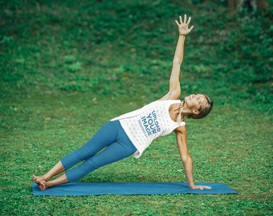 Mockup of a Woman Wearing a Tank Top While Practicing Yoga in a Forest Clearing 38740-r-el2