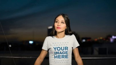 Pretty Girl at a Rooftop Wearing a Round Neck T-Shirt Mockup Video a13524