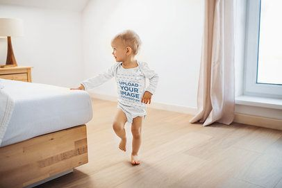 Onesie Mockup of a Baby Girl Playing in Her Parents' Bedroom 35221-r-el2