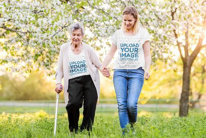 T-Shirt Mockup Featuring a Woman and Her Grandma Walking at a Park 39026-r-el2