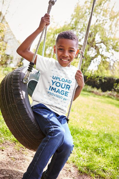 T-Shirt Mockup Featuring a Smiling Kid at a Tire Swing 35181r-el2