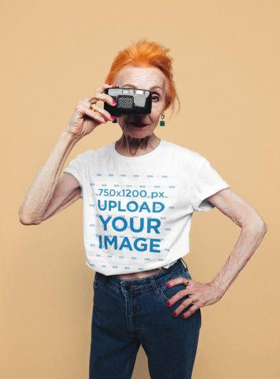 T-Shirt Mockup of a Senior Woman Holding a Camera 39059-r-el2