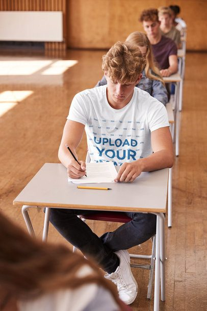 T-Shirt Mockup of a Young Man Taking an Exam 39088-r-el2