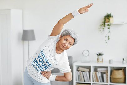 T-Shirt Mockup Featuring a Senior Short-Haired Woman Stretching at Home 39622-r-el2