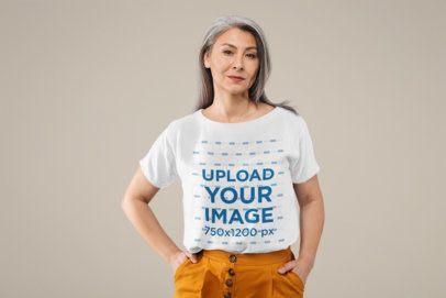 Mockup of a Senior Woman Wearing a T-Shirt and Posing at a Studio 39155-r-el2