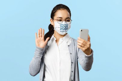 Studio Mockup of a Woman with a Face Mask Taking a Selfie 39107-r-el2
