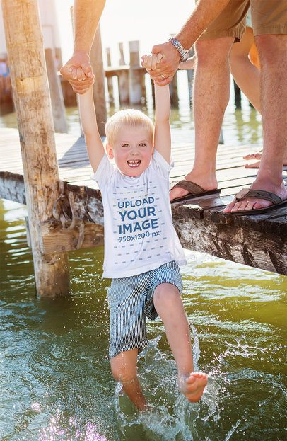 T-Shirt Mockup Featuring a Happy Kid Playing With His Father at a Lake 39276-r-el2